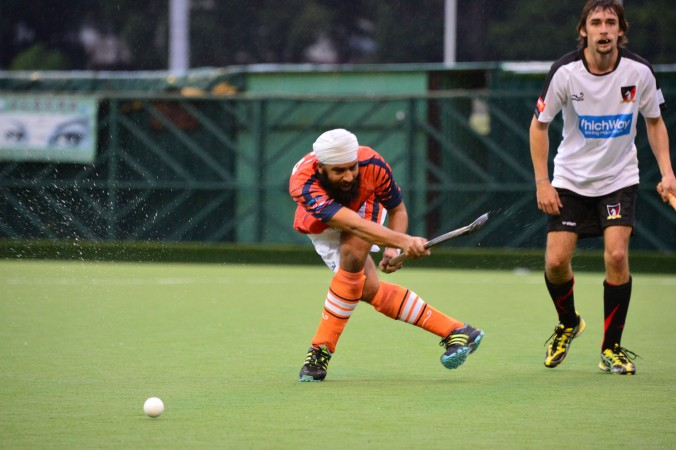 Khalsa-A's new ex-India international Harpal Singh distributes the ball.