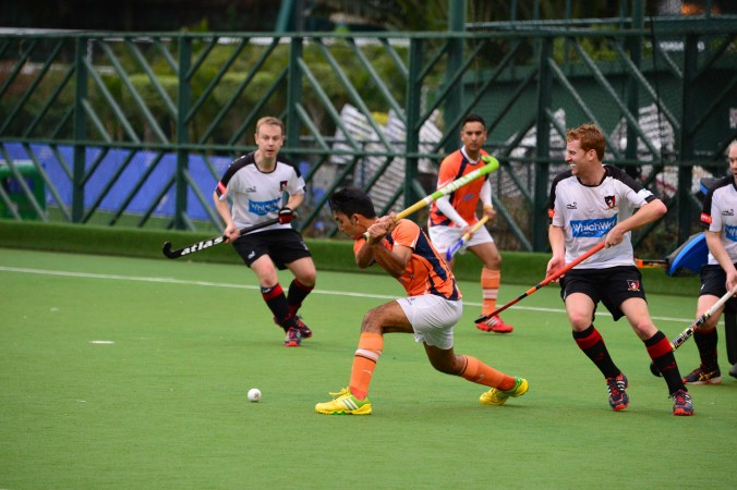 Khalsa's Ishtiaq Ahmed fires for goal.